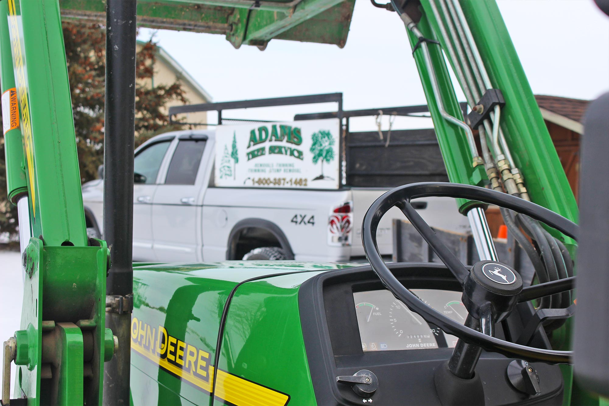 Adams Tree Service tractor and truck