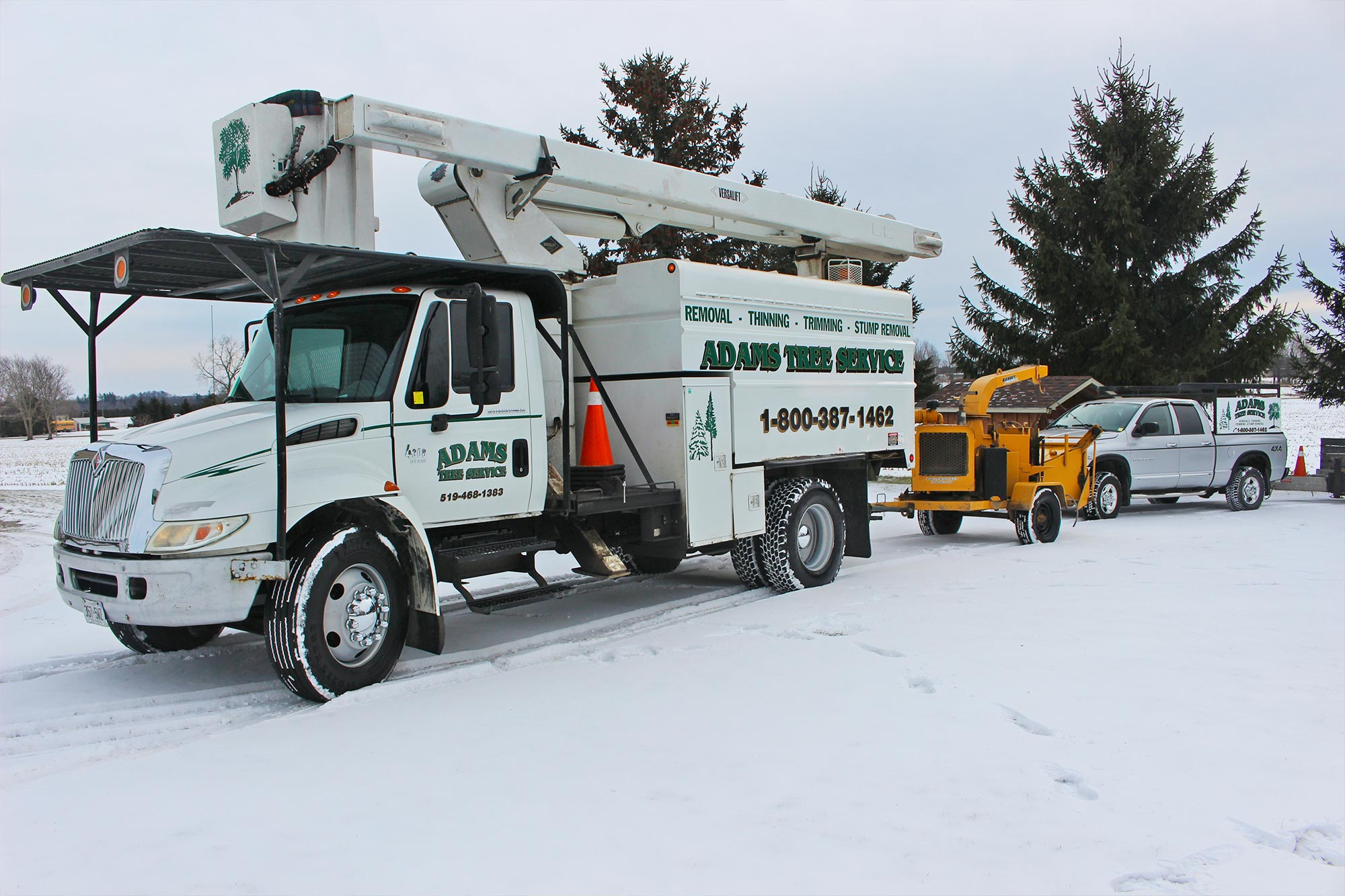 Adams Tree Service line truck and chipper