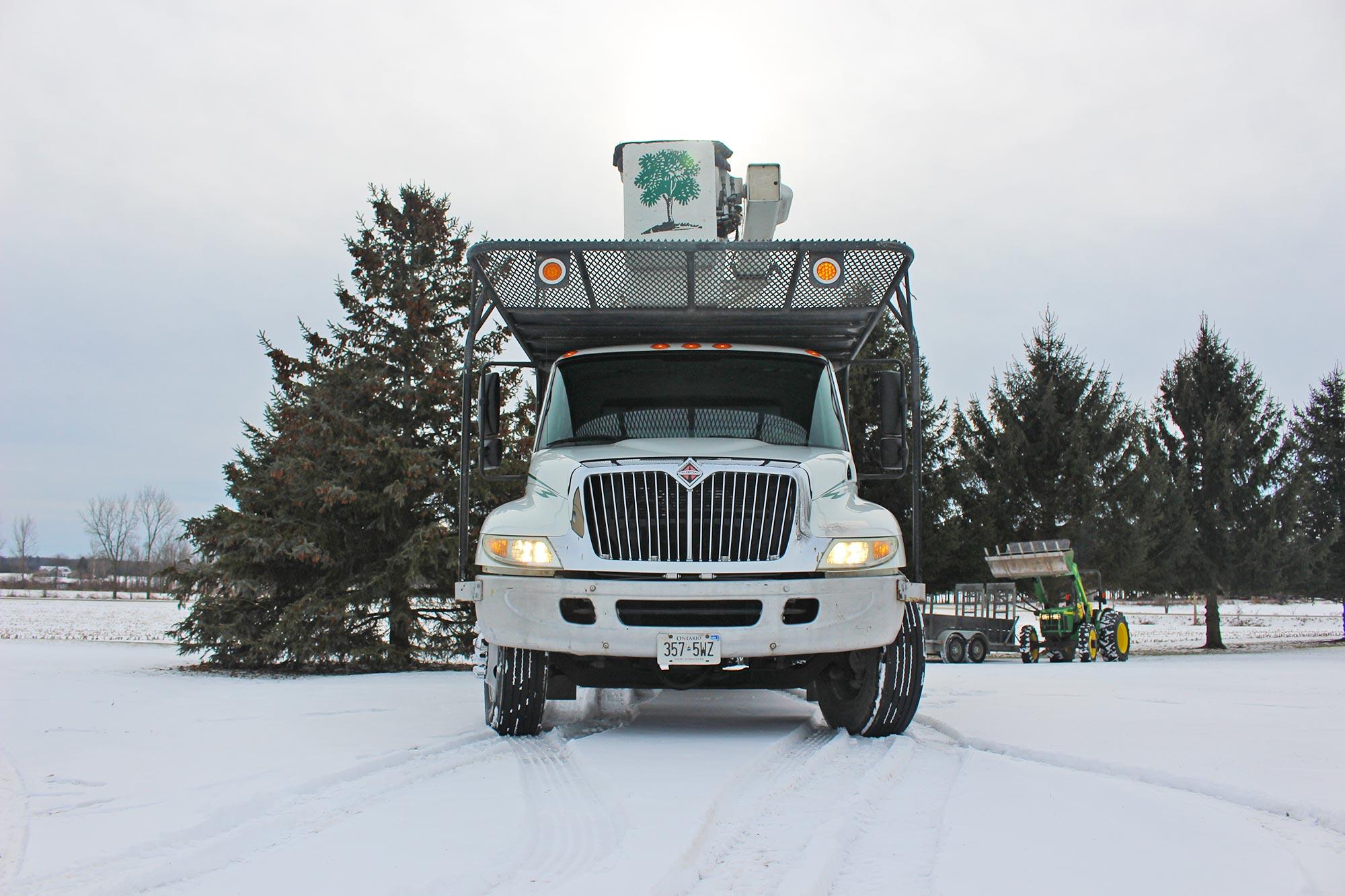 Adams Tree Service line truck